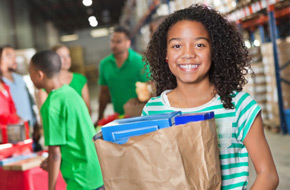 Young woman with bag groceries