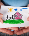 drawing of family next to a house